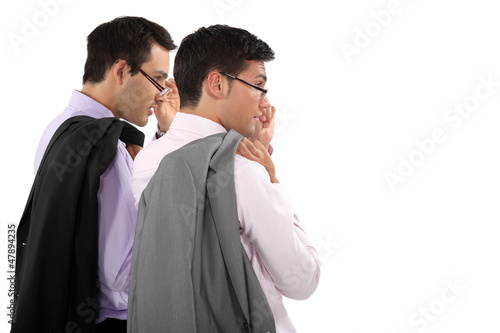 duo of young businessmen with glasses lowered