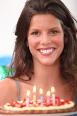 Young brunette with birthday cake