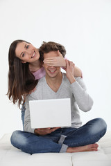 Couple with a laptop computer