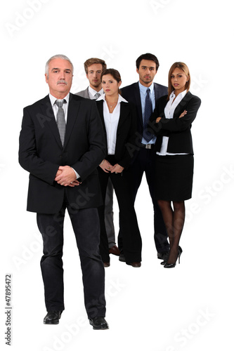 Studio shot of businessman and his team