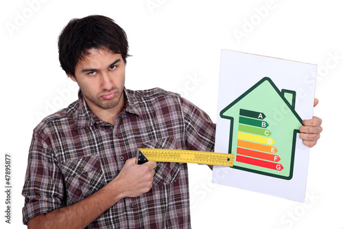 man pointing to the lower of an energy efficiency rating