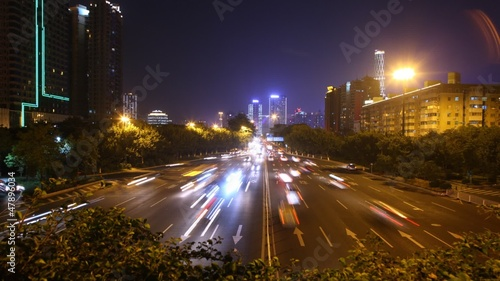 Cars go on night high-speed road towards Guangzhou Bridge
