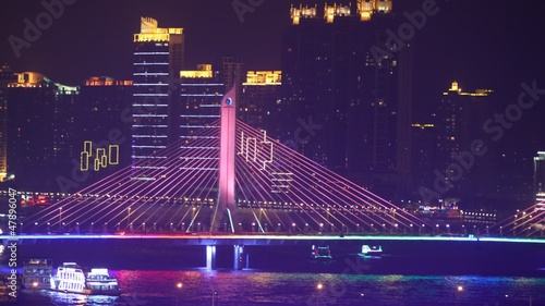 Haiyin Bridge stands in front of skyscrapers near to floating