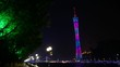 People walk in Hongcheng park near Canton tower