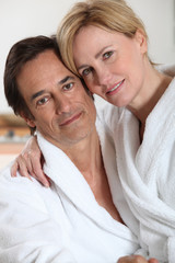 Couple wearing white bathrobes
