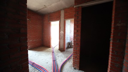 In under construction house of room and pipe with cold and hot