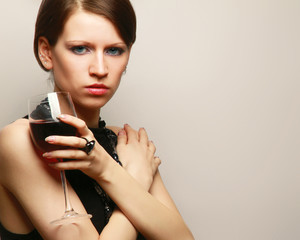 Portrait of a beautiful woman with a wineglass