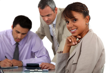 Three people in business meeting