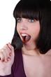Woman singing into make-up brush