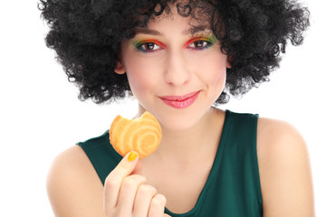 Funky woman eating cookie