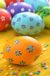 Easter decorations - eggs with painted flowers on the tabletop