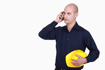 Bald architect making telephone call