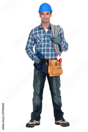An electrician with a drill.