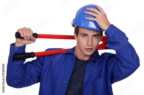 Manual worker posing with bolt cutters