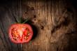 half tomato on wood