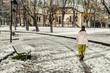 girl walking in snowy winter landscape
