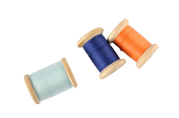 A wooden reels of thread