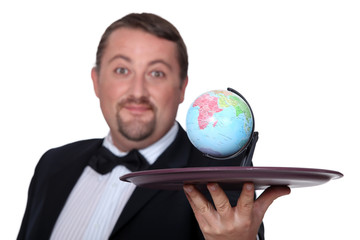Waiter with a globe on a platter