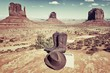 boots, hat and Monument Valley