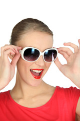 Studio portrait of a fun woman in sunglasses
