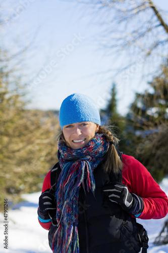 Woman hiker walking in winter mountains