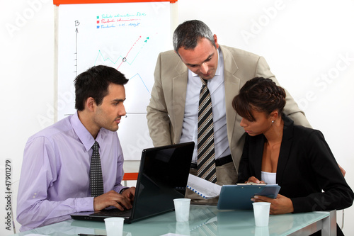 A team of business professionals working together