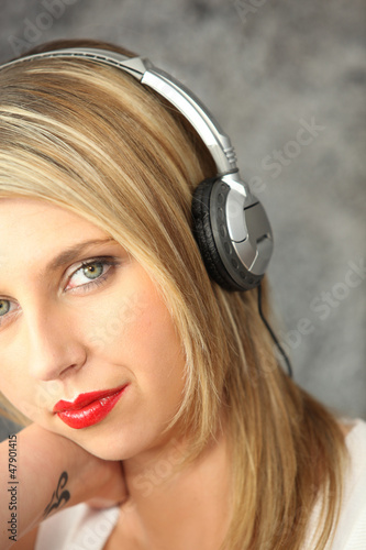 Woman listening to music with her headphones