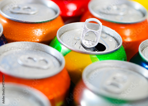 Cans of sweet drinks (or beer)