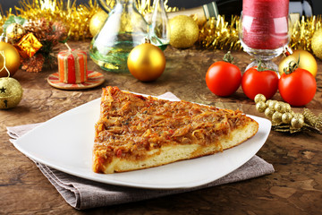Slice of pizza with onions