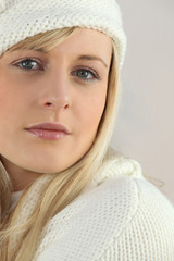 young blonde woman wearing a winter hat