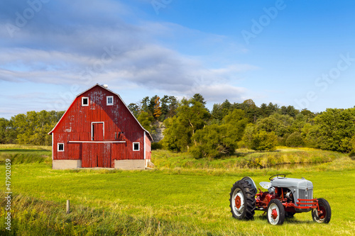 Traditional American Red Barn With Vintage Tractor