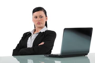 Women looking disgruntled computer