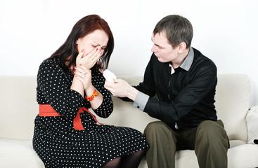 Man comforting his crying man