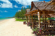 Tropical beach scenery with huts in Thailand