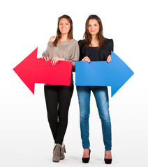 Two beautiful women holding red and blue arrow, left and right