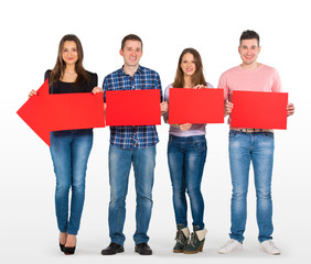 Group of people holding a long, red arrow