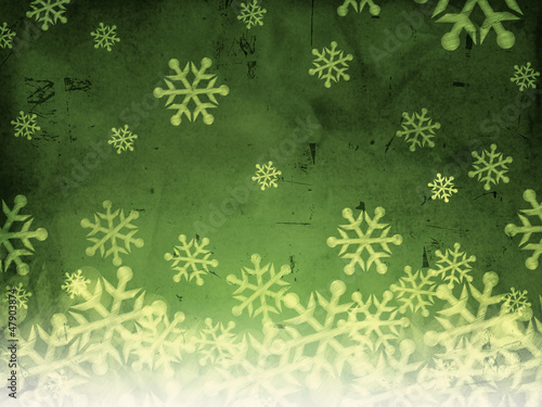 abstract green background with snowfall.