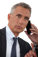 close-up of businessman talking on his cell