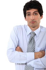 businessman standing with his arms crossed