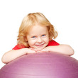 Happy child with fitness ball playing sports.
