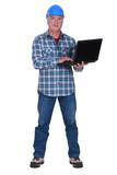 Tradesman holding a laptop poster