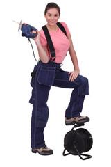 Tradeswoman holding up a jigsaw