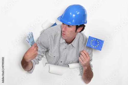 Tradesman holding a European Union flag and money
