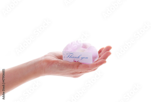 card with gratitude and a flower in her hand