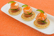 """Red salmon roll with chees, caviar and cucumber on"""" blinis"""""""