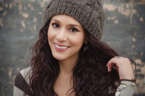 Young smiling woman in woollen beanie hat