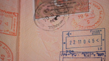 A passport with visas and stamps