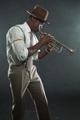 Black american jazz trumpet player. Vintage. Studio shot.