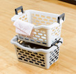 Stack of plastic baskets for laundry
