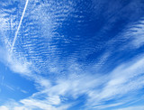 mackerel sky with contrail